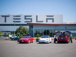 Promise of Tesla Piques Investor Interest More than GM Profit